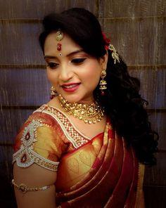 Traditional Southern Indian bride wearing bridal hair, saree and jewellery. Reception look. Makeup by Swank Studio. #BridalSareeBlouse #SariBlouseDesign   Find us at https://www.facebook.com/SwankStudioBangalore