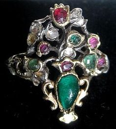 British Giardinetto Ring, ca 1720-1740. A Giardinetto ring literally means a small garden ring. A type of finger ring of which the bezel is made in an openwork floral design and set with small gemstones of various colors..Such rings were made in Italy in the late 17th and 18th centuries. Also made in England, such as this ring.This ring has a closed (foil) back.The rings from later periods had open backs.