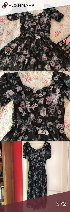 "Gorgeous vintage Laura Ashley dress In excellent used condition. Fabulous gray and black floral print on this vintage dress, with full, long skirt and open back with 3 bows . Hidden side zipper. 100% cotton. Measurements lying flat: bust 17"", waist 14"", hips free. Length from shoulder to hem: 49"". Laura Ashley Dresses"