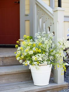 bucket with flowers at the front door
