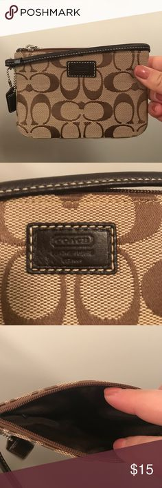 Coach wristlet Small monogram wristlet. Barely used; looks new. Coach Bags Clutches & Wristlets