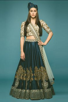navy blue lehenga, blue silk lehenga, motif lehenga, large motif lehenga, plant motif lehenga, planter motif lehenga, medium border, three quarter sleeve blouse, white and gold blouse, dupatta draping style, pale blue dupatta, turkish influenced lehenga,