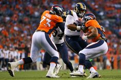 DENVER, CO - AUGUST 27: Defensive tackle Aaron Donald #99 of the Los Angeles Rams makes a tackle for a loss on running back Devontae Booker #20 of the Denver Broncos as Russell Okung #73 makes a block on Robert Quinn #94 during the first quarter at Sports Authority Field Field at Mile High on August 27, 2016 in Denver, Colorado.  (3720×2480)