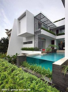 This is a dream balcony. I love open weave of the steel pergola panels.