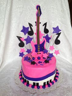 girl's pink and purple rock and roll cake with guitar and keyboard