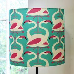 Flamingo lampshade, click though for other animal print lampshades. I want this!
