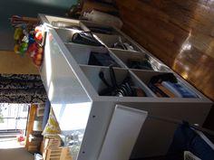 Ikea Expedit hack- bookshelf to kitchen counter/storage. Casters on bottom, custom-cut plexi on top.