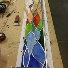 Leading a small window. One of my favorite parts of stained glass work! #stainedglass #gettheleadout
