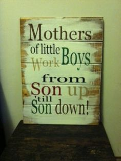 Mothers of little boys work from son up to son down sign