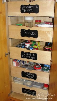 Organize your pull-out pantry drawers with labels!  See full Kitchen Tour {The Details}