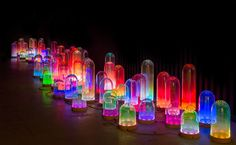Tinted glass bells with integrated LED circuit. I have some solar glass balls that change color. Will try putting under a glass dome. Maybe paint domes with alcohol inks. Would look cool in the garden - NOLA INSTALLATION