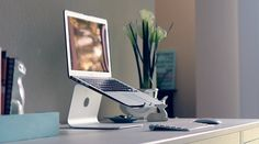 MacBook Air Station for clean and ergonomical desk. The raised laptop screen and separate keyboard prevents bad slumped over posture