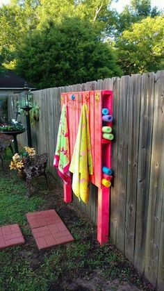 Towel hooks and swim noodle toy holder made out of pallets!  Cool idea to backyard pool area!