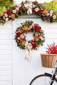 Garden shed decorated with natural festive wreath and garland.