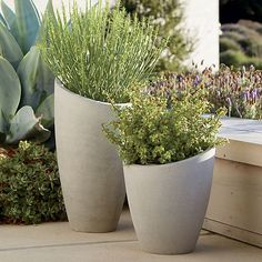 A slight slant to the rim trends these planters from the expected to the delightfully different. Statement pieces flank the door for a contemporary welcome or stage them together, short and tall, for a dynamic display of potted plants. Crafted of a lightweight combination of fiberglass, cement and sand that works indoors or out.