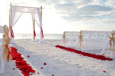 Red Rose Petals on the Beach. Wedding by www.perfectfloridabeachwedding.com Photography by www.boorayperry.com