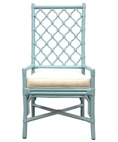 This lovely tall backed arm chair features Berber inspired lattice work. The chair is comfortable to lean against and creates an airy textured decor in a space when unoccupied. It works as a great com