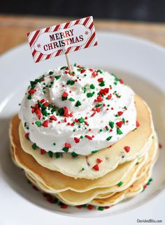 Enjoy these Merry Christmas Chocolate Chip Pancakes with Homemade Whipped Topping. Perfect for that Christmas morning!