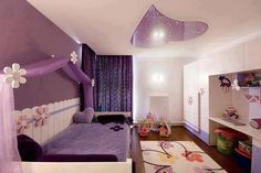 Back board on bed, handing fabric on wall, not pictures but add purple rug