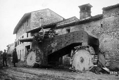 """The original caption reads: """"The Italian collapse in Venezia. The heedless flight of the Italians to the Tagliamento. Captured heavy and gigantic cannon in a village behind Udine. November 1917"""". Pictured is an Obice da 305/17, a huge Italian howitzer, one of fewer than 50 produced during the war."""