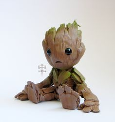 "mixed some different types of clay together for test, made this GoTG inspired chibi I have yet to see the new movie. . . but ""Groot"" looks cool this picture is life-size of the actual statue. ""Groo..."