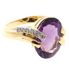 Amethyst and Diamond Gold Swirl Ring . Solid 18k yellow Gold swirl ring circa 1960 with bead set Diamonds and an exceptional oval bright purple Amethyst with unusually bright sparkle, approx. total weight 6.00cts, VS, 15.07 x 11.50mm, 6 round Diamonds, approx. total weight .06cts, G, SI1 18k yellow and white Gold Tested and stamped: 18k Hallmark: AS 9.6 grams. Width at top: 14.81mm. Height at top: 7.80mm. Width at Bottom: 1.14mm. •€1,624.77 ($1,990)