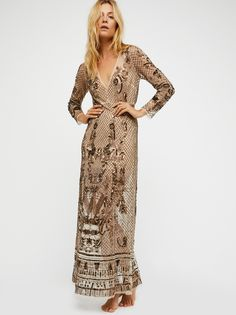 Art Deco Embellished Maxi Slip | Inspired by the glitz and glam of a past decade, this stunning ornate maxi dress features a sheer mesh design with stunning embellishments allover.    * Plunging V-neckline   * Sexy back slit detail