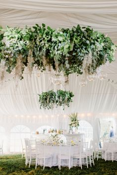 Stunning foliage chandeliers: http://www.stylemepretty.com/maryland-weddings/baltimore/2016/03/24/classic-elegant-maryland-horse-farm-wedding/ | Photography: Shannon Michele - http://shannonmichelephotography.com/