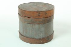 "SUGAR BUCKET.  American, early 19th century. Stave construction with wood bands and some rosehead nails. Traces of original blue paint. Age splits. 13""h."