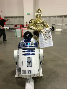 R2D2 and C3PO checking out the Bboy Feds clothing line | SLC Comic Con | spring 2014