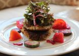 A crunchy almond flour fritter with spring lettuce, vegetables, and beet dressing.