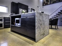 Stanton Studios' wood shop designed and fabricated these sleek, modern, black cabinets for a client's weekend getaway in Waco, Texas. The modern cabinet designs align with the overall industrial style of the home. Designed and fabricated by Stanton Studios. #custom #woodworking #cabinetry