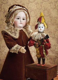 As in a Looking Glass: 14 French Bisque Jester Musical Automaton with Rare Character Face