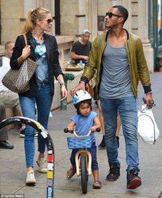 Dutch model Doutzen Kroes couldn't help looking at her handsome husband as the couple enjoyed a walk with their adorable son in NYC. #familytime