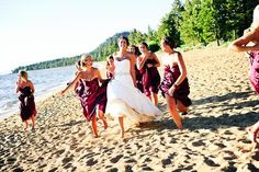A bride and her maids celebrate her wedding on the shore of Lake Tahoe.