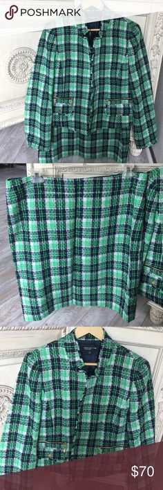"""Jones New York Green Plaid Skirt & Jacket.16300 Jacket is 21.5"""" in length from shoulder, 23"""" from side to side under arms, open closure with fringe, fringed stand-up 2"""" collar and fringed wrists of long-sleeves.. Each side has a 5"""" gold zippered pocket and underlying flap pocket with gold snap closure. Skirt: 2"""" waistband 39"""" around, hip measurement 46"""" around, length 23.5"""", back zipper closure, 6"""" open pleat central back @ hem. Both jacket & skirt fully lined in black polyester. Fabric is…"""