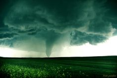Huge, long-lived tornado near Simla, Colorado today. At times, there were 2 tornadoes on the ground at the same time. Fantastic storm! 6-4-2015