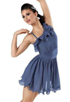 A delicate rose details the asymmetrical neckline of this georgette dress with attached matte spandex trunks. A shirred spandex front cummerbund and fishing line curly hem skirt are all attached. Includes sparkling barrettes.