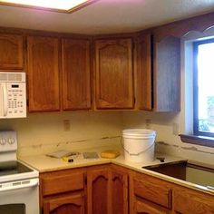 Best Budget Redo Before and Afters 2011  $1,200 Kitchen Transformation: Before    Who: Hope H.S.  Where: Cottonwood, Ariz.    We wanted to transform our dingy, circa 1989 ranch home kitchen with old ugly cabinets into a bright, timeless space with a vintage feel.