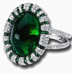 Cabochon Emerald and Diamond Ring.                                                                                                                                                                                 More