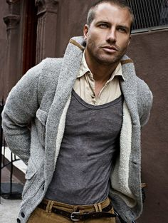 Like the shawl collar (and the man wearing it). Don't know about the heather grey top over the button down; rumpled.