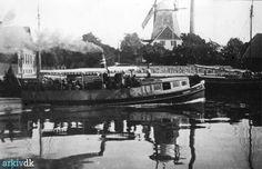 arkiv.dk | Dampbaaden Lillebelt i Fredericia, 1897. I baggrunden ses havnemøllen.