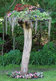 Maybe use a spool top and terra cotta pots on top of the dead oaks