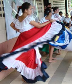 Traditional dances are part of Costa Rican culture. Colorful skirts and white blouses move with the marimba music.