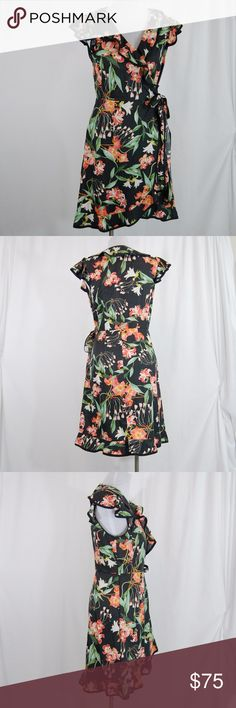 "Anthropologie Floral Flutter Sleeve Dress Brand: hi there (at Anthropologie).  Faux wrap dress style. Attached belt ties at waist. Single snap button at bust to keep it modest (see pic). Flutter cap length sleeves with a ruffle style lapel neckline. Side zipper. Unlined. Hem comes up in front center.   Excellent condition with little to no signs of wear  Approx measurements (taken flat & with belt tied at waist): --Length = 38""  --Bust = 19"" --Waist = 14"" (estimated since belt can be…"
