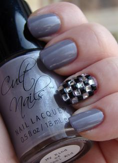 Love that checked bling accent nail!  Maybe with white polish for ska concert