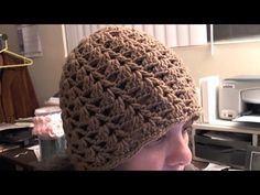 Step by step video tutorial on how to crochet a half shell cluster cap/beanie.  This easy to follow  step by step video will teach you what you need to do to crochet this beautiful cap.  This crochet pattern gives it a swirl appearance that is very attractive.  Different than regular shell patterns, unique look.  This is an adult size cap.  To m...