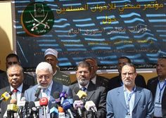 The Real Arab Spring: Members of Egypt's Muslim Brotherhood including now-President Mohamed Morsi (3rdL) take part in a press conference in 2011. The supreme guide of the Muslim Brotherhood, from which Morsi emanated, called on Thursday for a jihad (holy war) to liberate Jerusalem from Israeli rule.