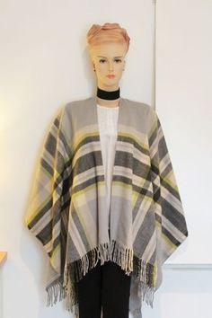 There is a FREE sewing pattern and full tutorial for this blanket poncho. Head to Greenie Dresses for Less blog to find it. #sewing #diyfashion #blanketponcho