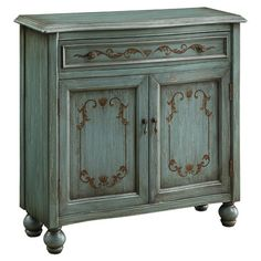 Found it at Wayfair - Dearington Cabinet in Tealhttp://www.wayfair.com/daily-sales/p/Best-Sellers%3A-Accent-Furniture-Dearington-Cabinet-in-Teal~CTCI2955~E14506.html?refid=SBP.rBAZEVQRpZ5Nq30QS_2UAi42LqalM0inpKArSd13EoU